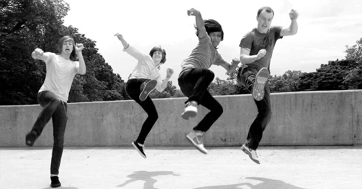 Four young Ohioians jumping.