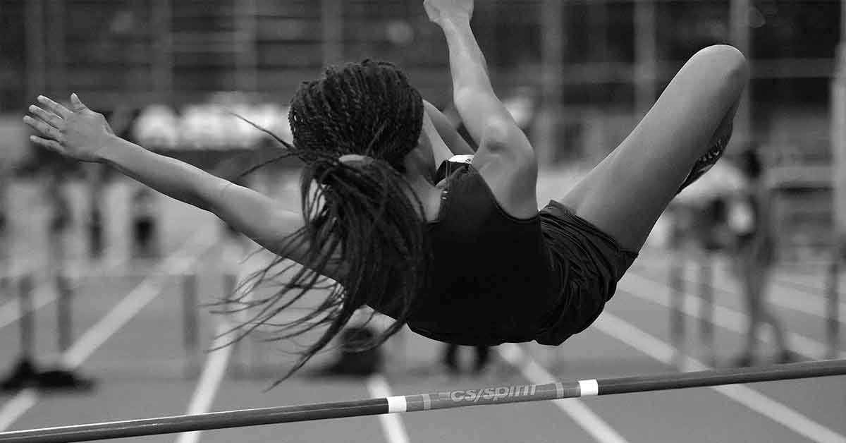 Girl clearing the high jump bar in NYC.
