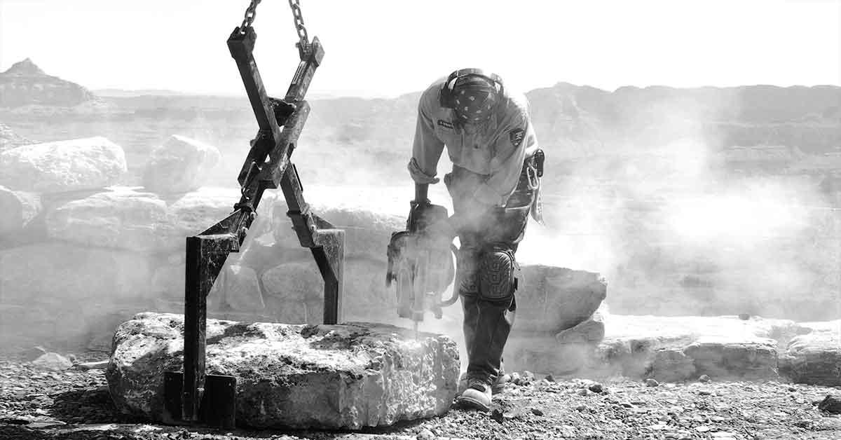 Sawing a stone slab.