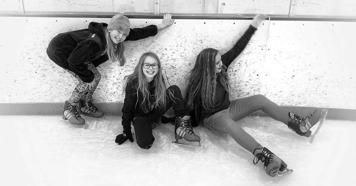 Girls ice-skating in Omaha.